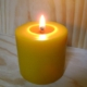 Image of a candle on the Altar